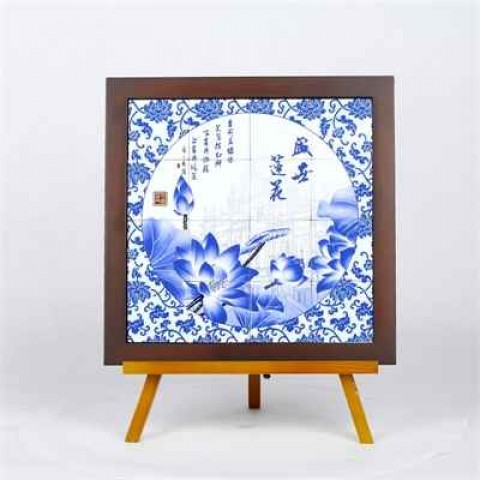 Porcelain tiles painted with images of Macao's World Heritage sites in a Chinese style wooden frame (33cms x 33cms)
